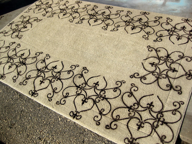 This new DIY stenciled rug project is complete! Let dry completely before moving back into your home.