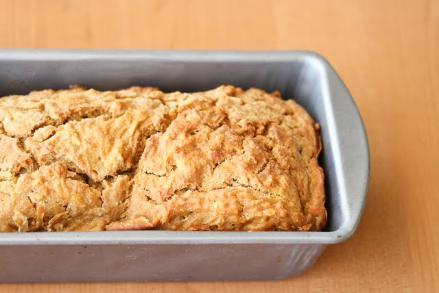 overhead photo of a loaf of Pumpkin Ale Bread in a baking pan