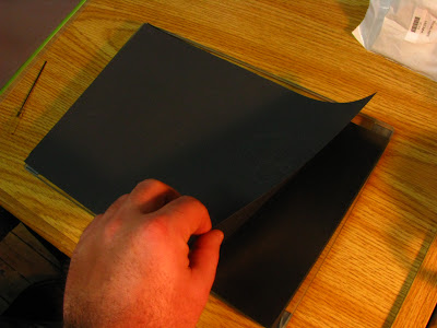 polishing paper on rubber pad on glass platform