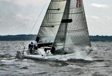 J/29 Hustler sailing fast upwind on Long Island Sound