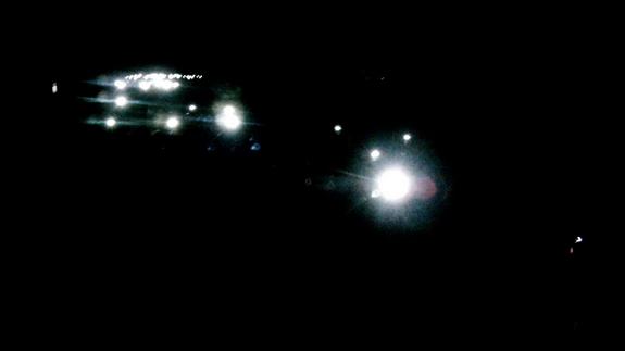 Frontales dans la nuit, sur le Causse Noir