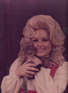 Dolly Parton and a cat