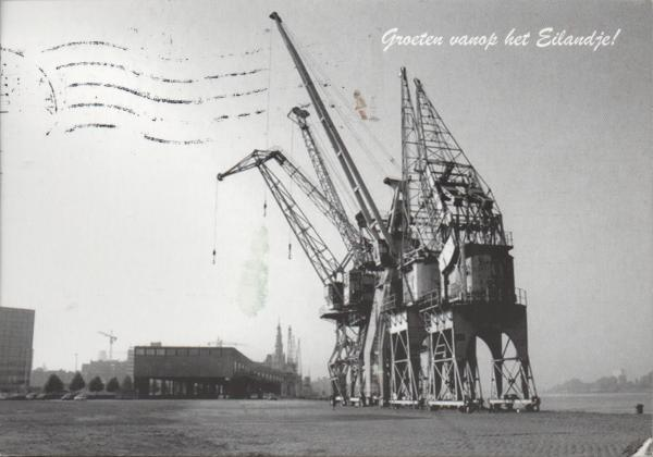 several old cranes beside a dock
