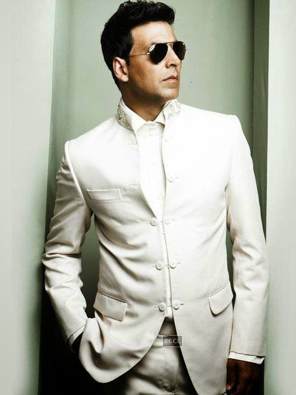 Over the years, not only his look but also his style has evolved. Akki has been named the Sexiest Man Alive by People (India) magazine in 2004. Click next to Ajay Devgn's yesteryear look!