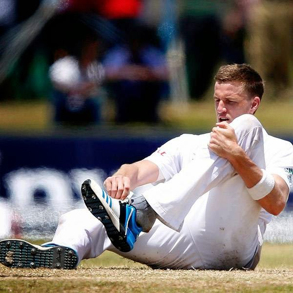 South Africa's Morne Morkel changes his shoes during the fifth day of their first test cricket match against Sri Lanka in Galle July 20, 2014.