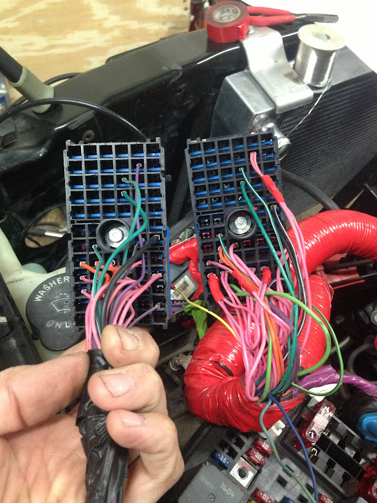 the top cluster i took the old wiring harness 101 plug off and wired to the  100 plug on the 5 3  on the lower end of the pic i took the fuel