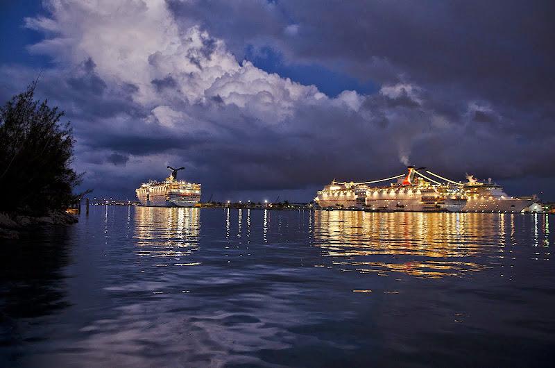 Cruise ships at night. Cruising travel hacks