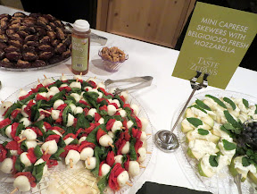 Taste of Zupan's- Hors D'Oeuvres of Mini Caprese Skewers with Belgioioso Fresh Mozzarella, and in the back left Medjool Dates with Cashel Blue Bites, to the right Belgioioso Burrata Bites