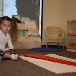 Montessori preschool girl working with red rods math material in private school in Irvine.