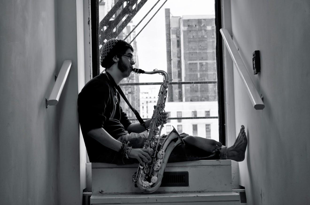 Saxophonist Kyle Madsen serenading the halls of Roosevelt's Auditorium Building