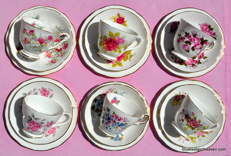 Mismatched vintage teacups with pink flowers
