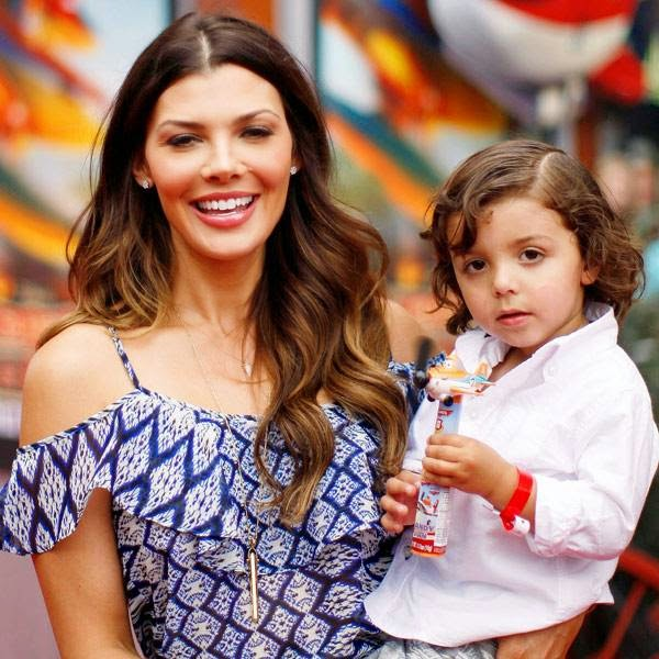 Actress Ali Landry holds her son Marcelo Alejandro Monteverde after arriving at the premiere of 'Planes: Fire & Rescue' at the El Capitan Theater in the Hollywood section of Los Angeles, California, July 15, 2014.