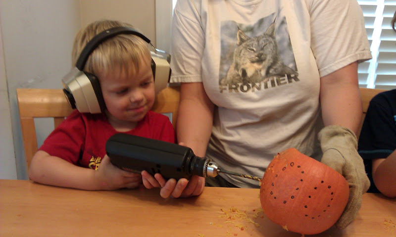 The bigger boys drilled some pumpkins