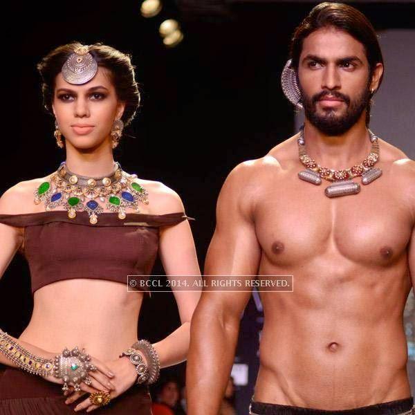 Models showcase a design by 'Apala' by Sumit Sawhney on Day 1 of India International Jewellery Week (IIJW), 2014 at Grand Hyatt, Mumbai.