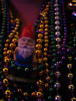 a gnome with beads in NOLA - tipsyterrier.blogspot.com