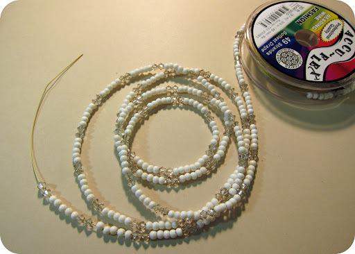Mini bone beads and Swarovski crystals were threaded on bead cord.