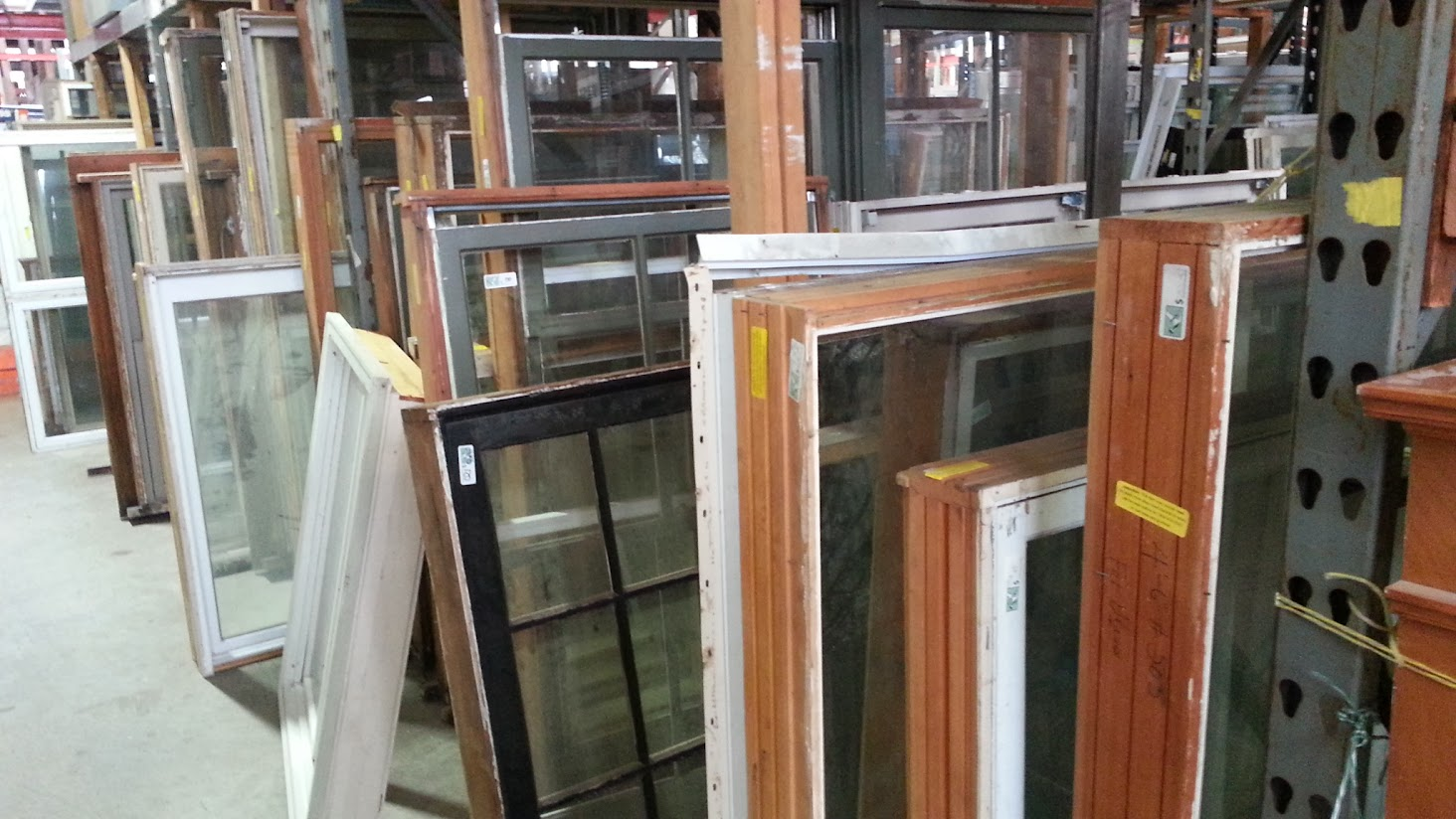 a row of used windows in the Rebuilding Center warehouse