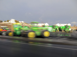 motion blurred picture of green tractors