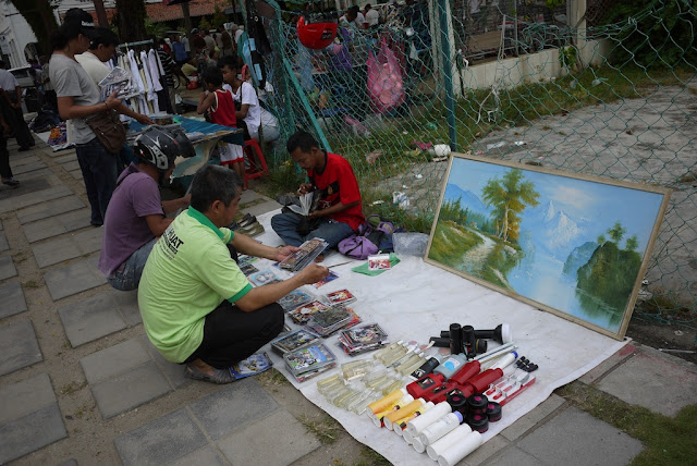 painting for sale at an outdoor market in George Town, Penang, Malaysia