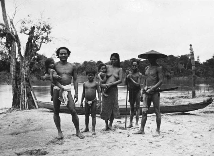 Portrait of a Dayak Punan group at the river, Borneo