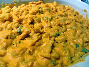 Pumpkin Mac and Cheese Recipe: After making the cheese sauce, stir it into the pasta until well mixed, then pour into a baking dish