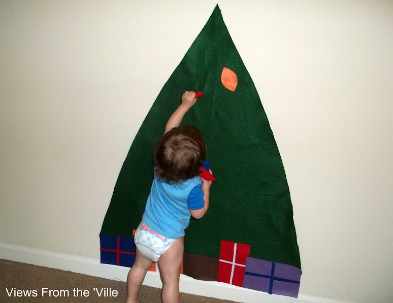 Decorating the felt tree with felt ornaments
