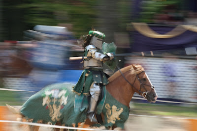 The knight's helmet makes a fine point of focus here.  The lance would not have worked as well due to it's vertical motion.