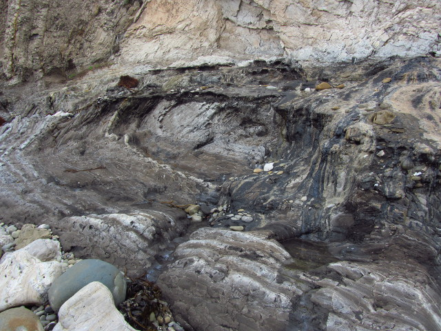 thick oil flowing slowly down the rocks