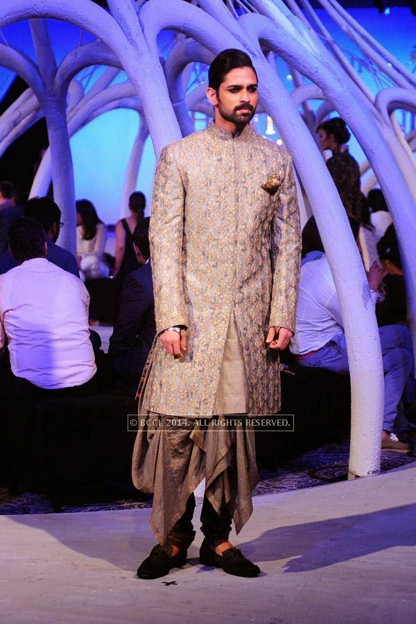 A model walks the ramp during Shantanu and Nikhil's Autumn Winter Couture show in association with Johnnie Walker Black Label and JW Marriott New Delhi Aerocity.