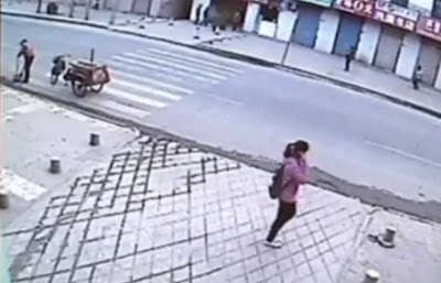 China: Teen girl on cellphone swallowed by sink hole