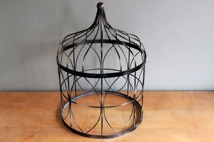 Large bronze birdcage available for rent from www.momentarilyyours.com, $4.00.