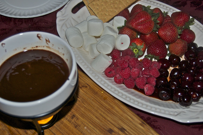 chocolate fondue with fresh cherries, strawberries, raspberries, marshmallows and graham crackers