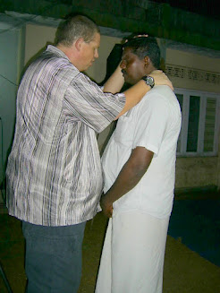 Praying with a church leader in Kerala