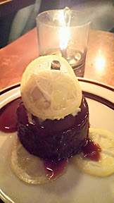 Park Kitchen Sticky date pudding with vanilla-rum ice cream and confit lemon