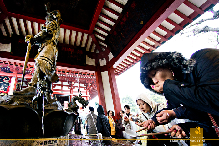 Cleansing with Water at Asakusa's Sensoji Temple