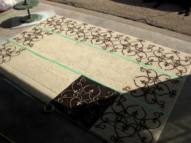 Continue to move the stencil around the outside of the rug, making a border around some empty space in the middle of the rug