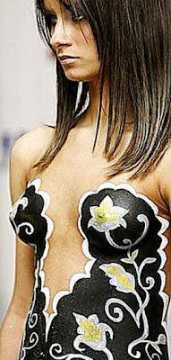 Models present body art creations