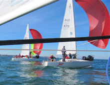 J/24 one-design sailboats- sailing downwind off Australia