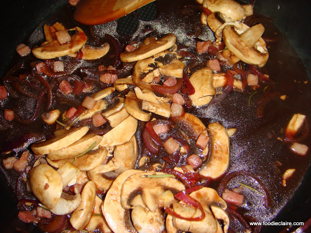 stock, mushrooms, pancetta, red wine, rosemary and seasoning is added to the caramelised onions