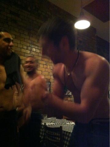 A blurry shot of three topless men.