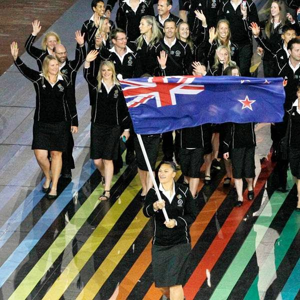 New Zealand's flag bearer Valerie Adams leads her team during the opening ceremony for the Commonwealth Games 2014 in Glasgow, Scotland, Wednesday July 23, 2014.