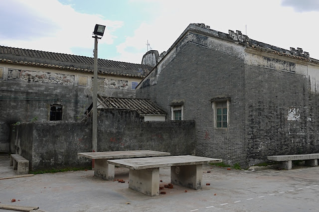older buildings and cement ping pong tables in Beishan Village, Zhuhai, China