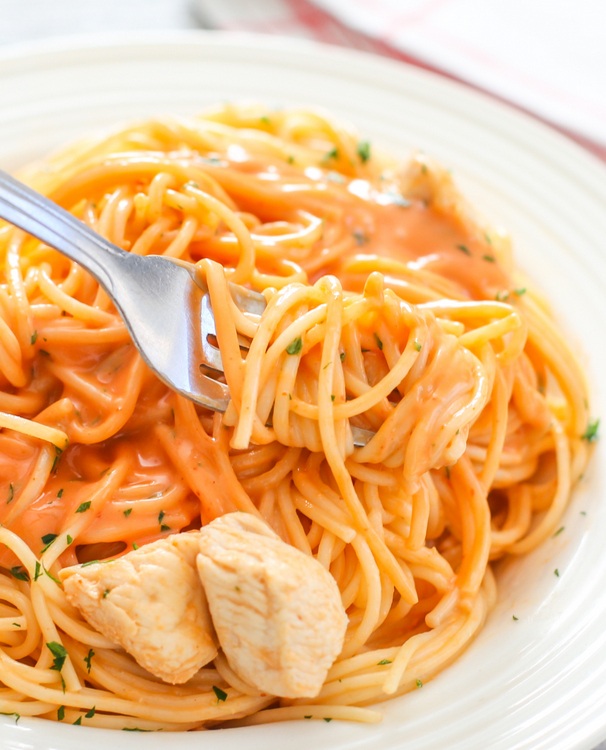 photo of a fork twirling pasta with bang bang sauce
