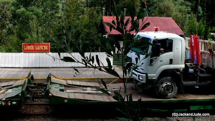 The work train takes two trucks out with loads of salvage Huon Pine.