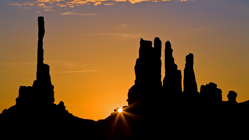 Sunrise at the Totem Pole and Yei bi Chei Formations, Monument Valley, Arizona.jpg
