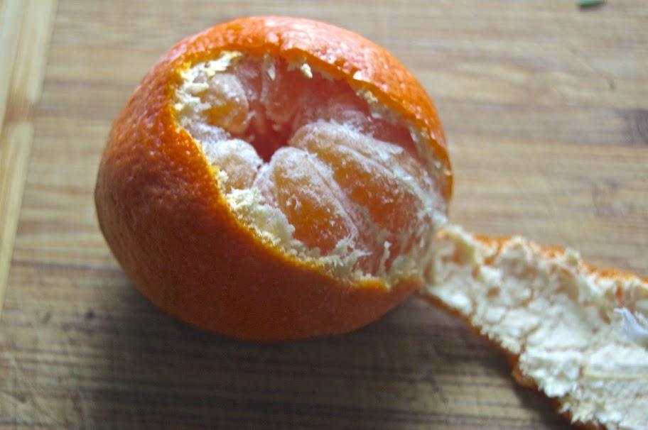 half-peeled satsuma