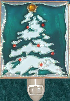 tree with snowfall and decorations