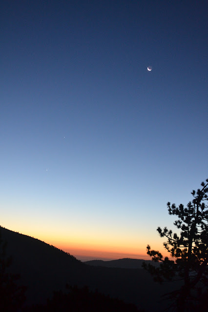 crescent moon over the dawn light