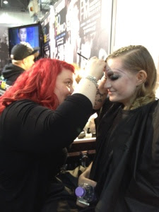 Makeup artist working on model