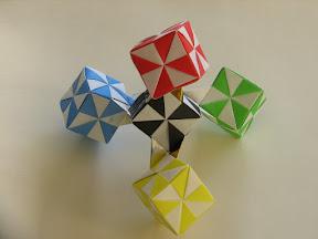 "Tetrahedra of Five Pinwheel Cubes in Tomoko Fuse's ""Multimensional Transformations: Unit Origami"""